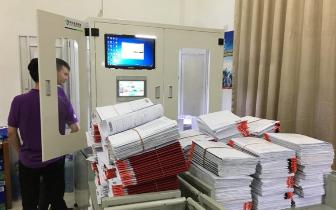 东莞不动产登记中心引进机器人打证 商品房办证提速