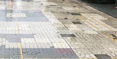 """樱花广场地砖破成""""马赛克""""一直未修"""