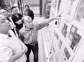 太原一社区举办国庆主题烟标展 记录祖国发展变化