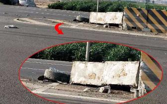 这车把水泥隔离墩都撞翻了 轱辘也掉了!