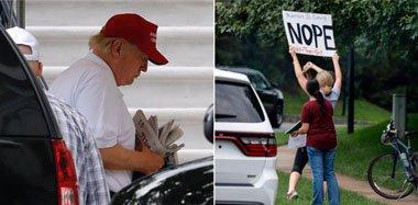 特朗普打完高尔夫回白宫 民众举牌抗议