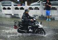 外媒镜头下的北京暴雨