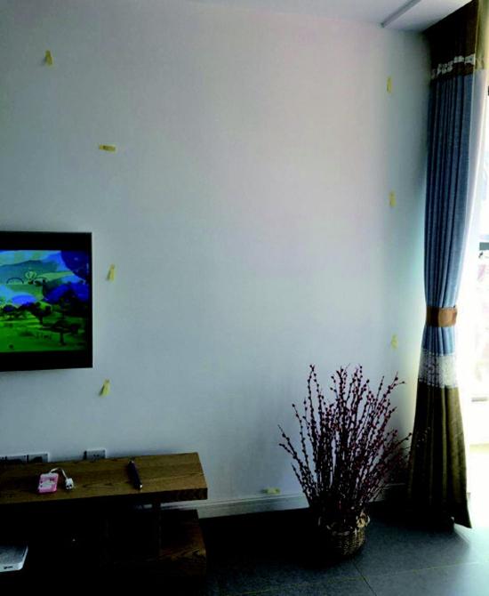 胶州中央公园房子墙壁空鼓 开发商:配合维修