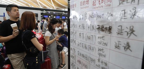 受台风影响上海两大机场部分航班延误或取消
