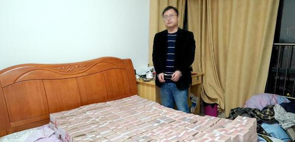 特大传销案被破获 4700万现金堆满床