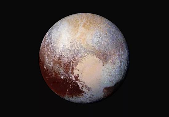 NASA拍摄的彩色冥王星,又大又亮又圆/视觉中国