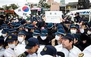 韩日民众游行发生冲突