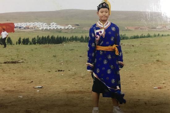 小学时期的张泽龙是个小胖子
