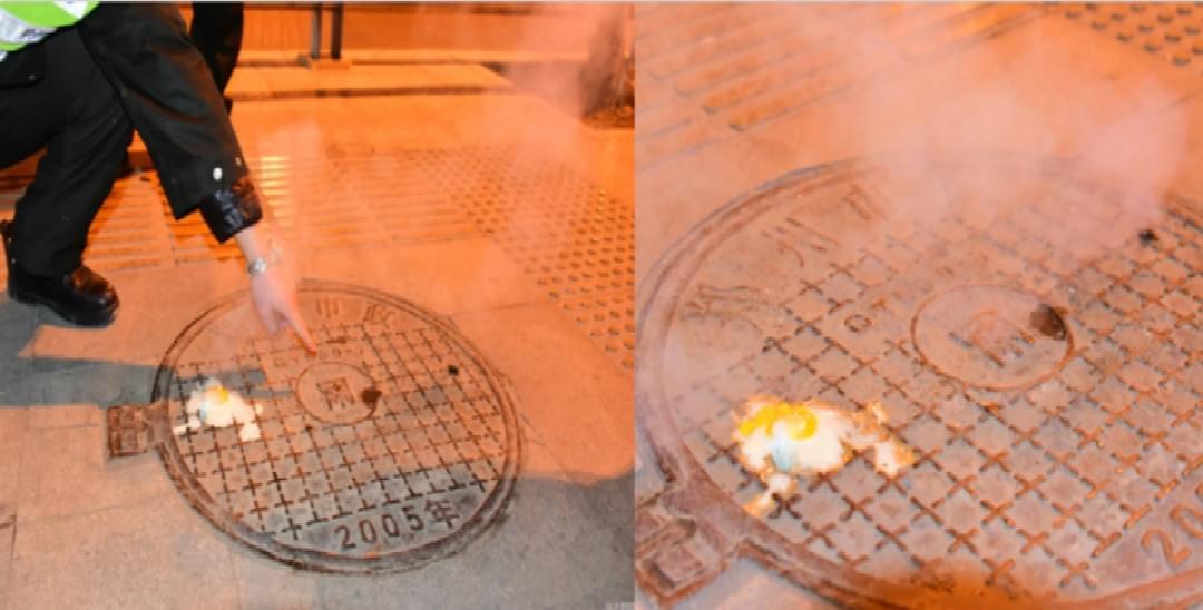 街头窨井盖冒热气 5分钟煮熟鸡蛋