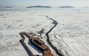 辽东湾呈现千里冰封景象