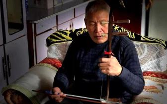 长治县古稀老人自制乐器献艺央视