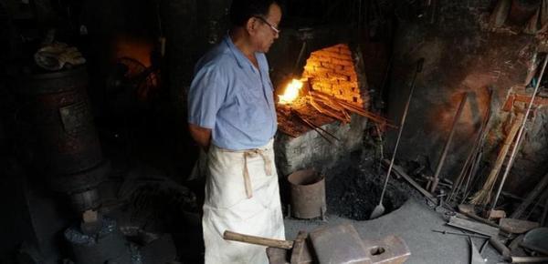 图片故事:江南小镇最后的铁匠
