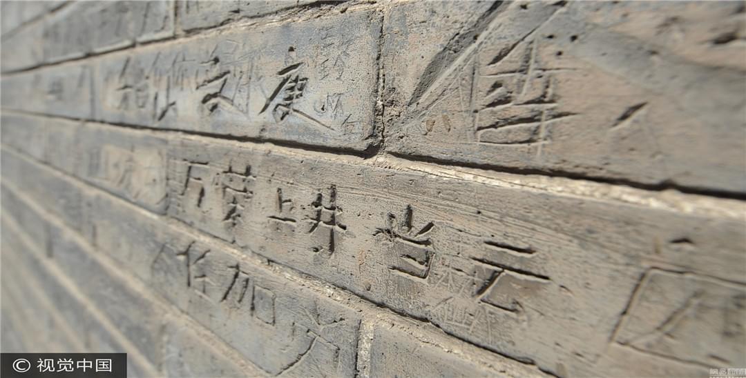 太原现存明代最高双塔刻字留名现象严重