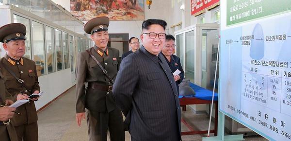 金正恩视察研究所 要求扩大生产导弹头