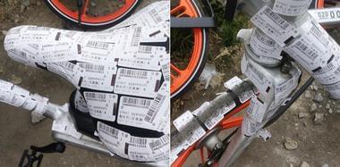 """广州共享单车停路边 被贴成""""大花脸"""""""
