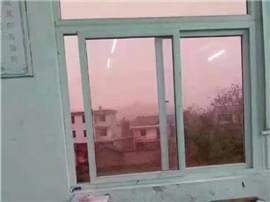 粉红色天空引担忧 环保局:阳光折射的霞光