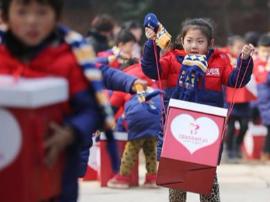 """""""暖流计划""""志愿者走进陕州区开展结对帮扶活动"""