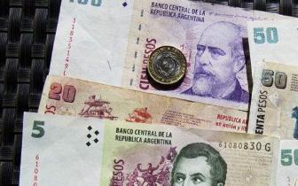 阿根廷三次绝望式加息稳比索 还面临美元走强考验