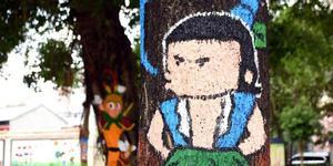 """校园树干化彩妆变身""""童话世界"""""""
