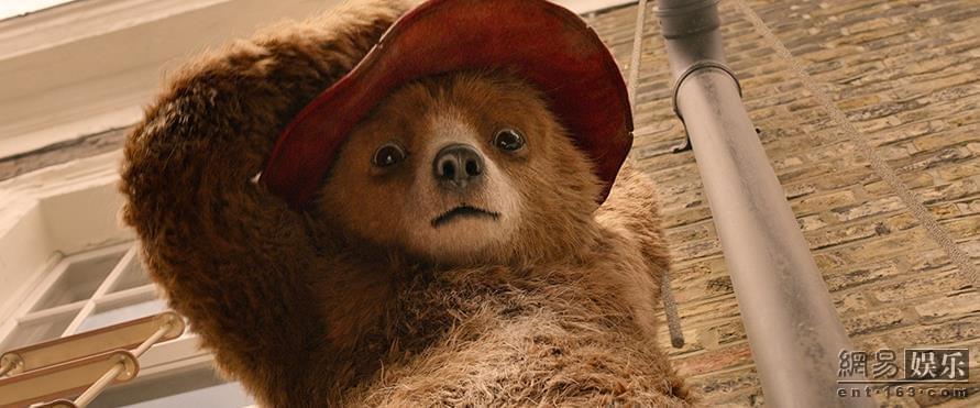 还记得那只头戴红帽子,身穿蓝色牛角扣大衣的帕丁顿熊吗?