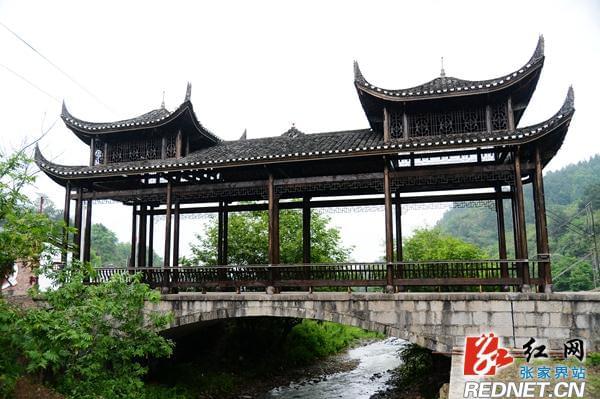 致富不忘家乡 武陵源一农民党员捐21.8万元建风雨桥