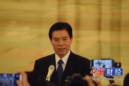 """新任商务部部长钟山""""首秀"""":贸易发展方式要调整"""