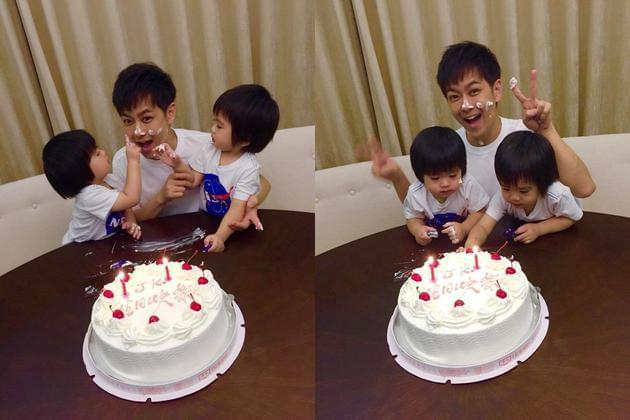 小寿星蛋糕当前,不先吹蜡烛、小手忙帮爸奶油洗脸。