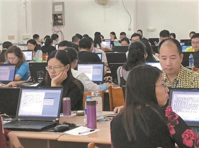 广东高考语文英语作文实施双评 误差超6分要三评