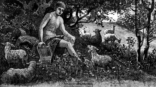An engraving of a shepherd with his sheep (Credit: FromOldBooks.org/Alamy)
