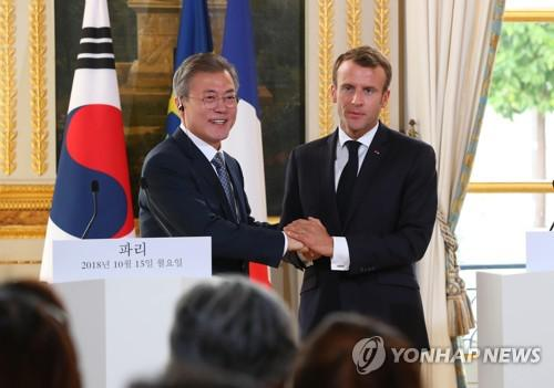 文在寅游说法国总统放松对朝制裁 韩媒:罕见