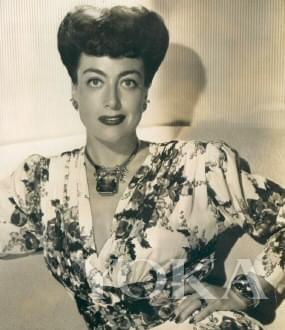 琼·克劳馥佩戴黄水晶珠宝套装。