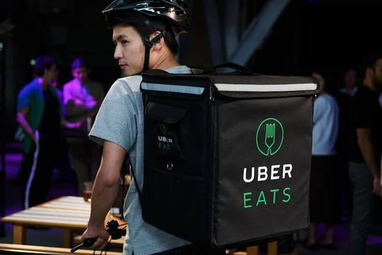 An employee at an event for the UberEats food-delivery service in Tokyo.