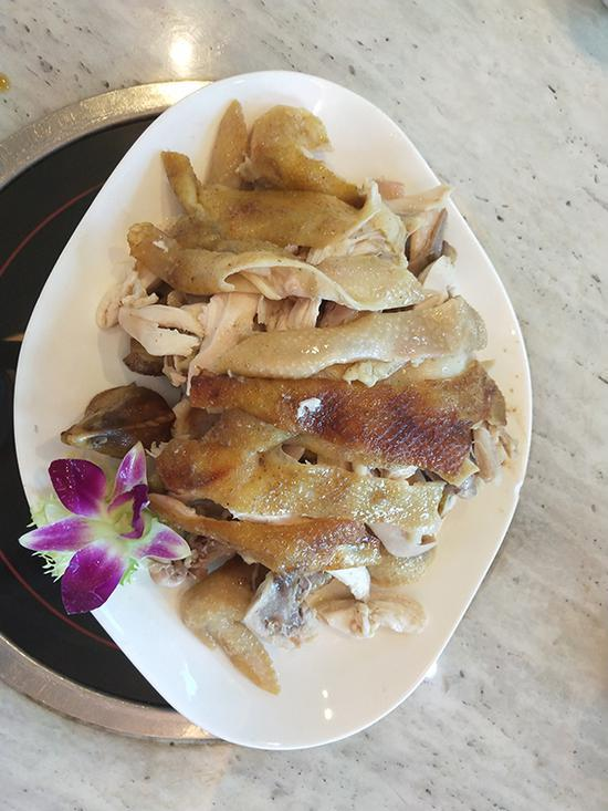 体验纪录片《舌尖上的中国》中播出的盐焗鸡