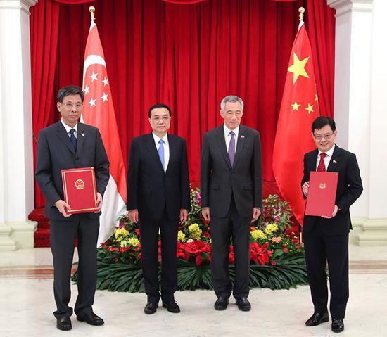 """刘昆与新加坡财长签署换函 宣布新加坡核准 《""""一带一路""""融资指导原则》"""