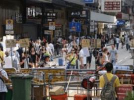"""香港""""占中""""9人抵警署接受预约拘捕 本周四开审"""