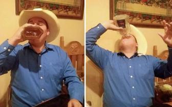 玩命!美国男子为200美元30秒内喝完整瓶威士忌