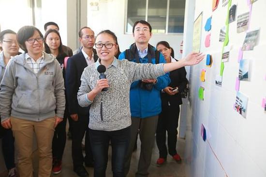 美丽中国支教老师罗悦悦带领大家参观大寨中学